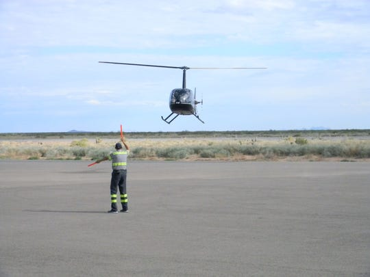 End of journey, helicopter guided to a landing at Santa Teresa Airport.