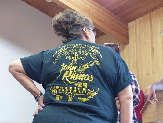 Tressa wearing John Ramos shirt