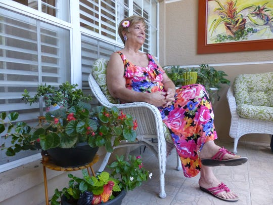 Juliette Lane, 74, sits inside her home's lanai, recalling her life in Hawaii, and birthday on Dec. 7, 1941, the day of the Pearl Harbor attack. She celebrates her 75th birthday on the 75th anniversary of the attack.