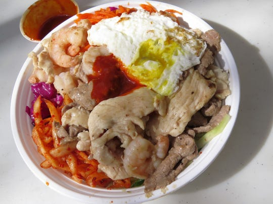 Stone bowl rice is a close relative of Korean Bibambap, rice topped with piles of colorful raw or pickled vegetables, meat, an egg and a dab of sweet and spicy sauce.