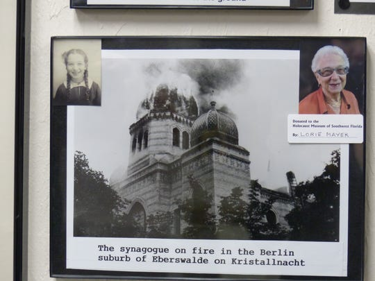 Inside The Holocaust Museum & Education Center of Southwest Florida, thousands of photos and artifacts live, including many of Lorie Mayer's donations, including this photo of a synagogue on fire in 1938.