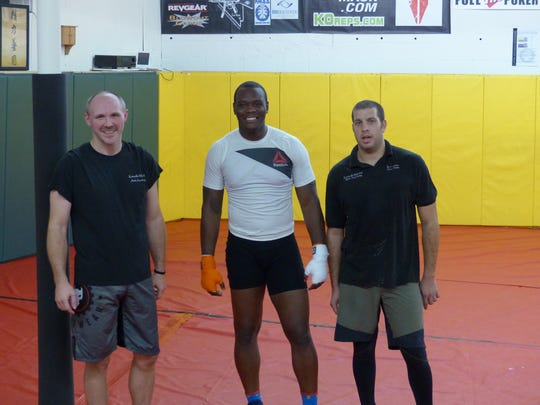 Flanking Ovince St. Preux are Eric Turner, left, the owner of Knoxville Martial Arts Academy and St. Preux's head coach, and Joey Zonar, St. Preux's manager