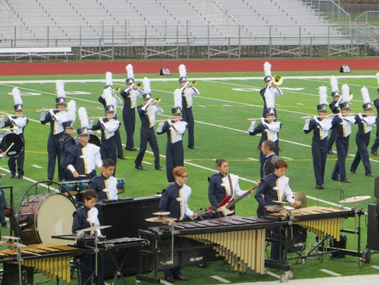 The 53-member South Lyon Pride of Lions marching band