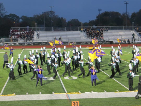 The 182-member Novi High School marching band, directed