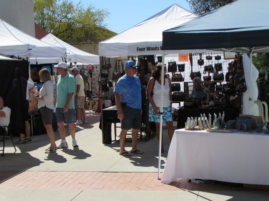 Visitors at last year's Holiday Artisans Market at the Tucson Museum of Art shopped in shorts-perfect weather.