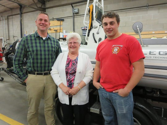 Town of Jacksonport Assistant Fire Chief Aaron LeClair, Contributions Committee Chairperson Marlene Larson of the Jacksonport Women's Club and Austin Gulley, Jacksonport firefighter/EMT, celebrate the JWC donation for water rescue equipment.
