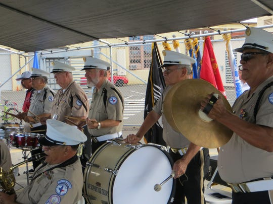 Members of the Veterans Band of Corpus Christi's percussion section perform during the decommissioning ceremony of the USS City of Corpus Christi at Pearl Harbor in Hawaii earlier this year.