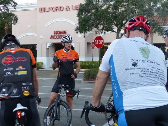 Paul Carbone, ride leader of Naples Velo Bicycle Club, reminds cyclists about road safety, and explains route on Nov. 30, 2016. The club recently released a safety video spotlighting the 3-foot rule.