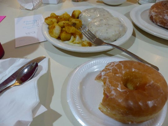 My meal, consisting of a glazed doughnut, and biscuits and gravy with a side order of home fries at Trackside Donuts & Cafe on Old 41 Road. Trackside is a breakfast staple in Bonita Springs, open every day of the week, serving freshly-made breakfast meals, doughnuts, and coffee.