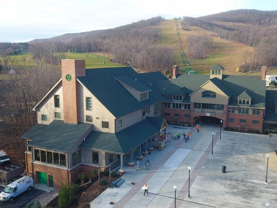 An $8.5 million addition, left, to the Whitetail ski lodge includes a restaurant, cafe and pizzeria.