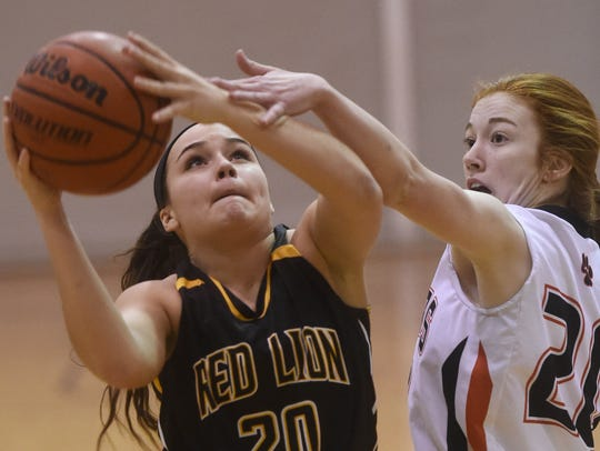 Central York's Emma Saxton, right, gets a hand on Red