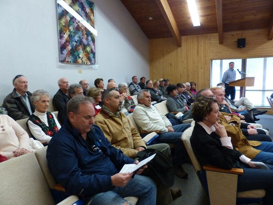 The chamber was packed for the meeting at village hall.