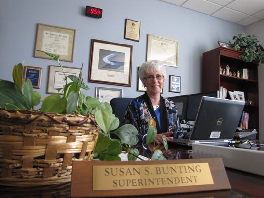 Indian River School District Superintendent Susan Bunting sits at her desk at the district office in Selbyville.