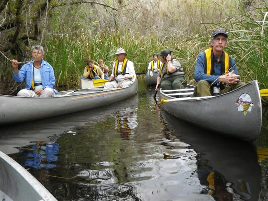 Nature Festival participants take a canoe ride.