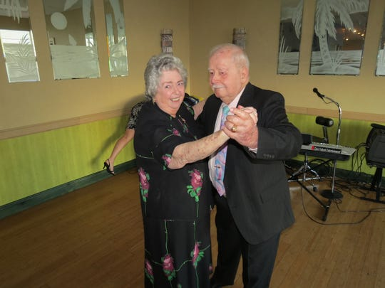 Dee Negroni-Hendrick and her husband, Don Hendrick, dance at the celebration of their 25th wedding anniversary in 2013.