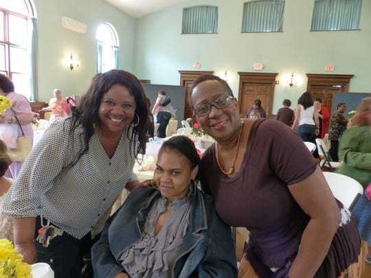 Rita Bakr, right, and her two Mentoring Moms mentees, Tracey Dickson, left, and Shanique Bullock.