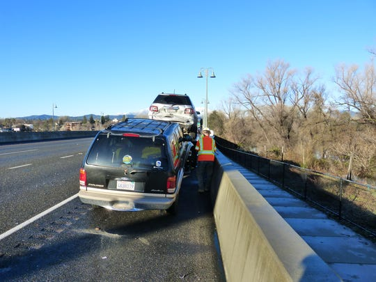 A tow truck loads two vehicles involved in a crash Tuesday on westbound Highway 44 in Redding.