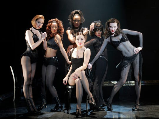 Terra C. MacLeod as Velma Kelly, surrounded by the