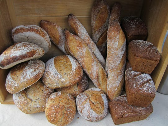 Simple Bread sells freshly baked loaves at Asheville City Market's winter market on Saturdays.