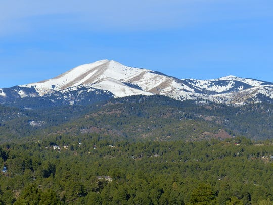 Snowpack melt shows on Sierra Blanca Peak and surrounding