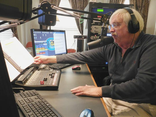 Gary Kline speaks on air from the studio of WRGG, a