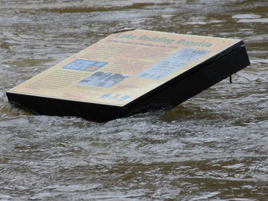 A sign about the Lake Redding Regatta was nearly covered