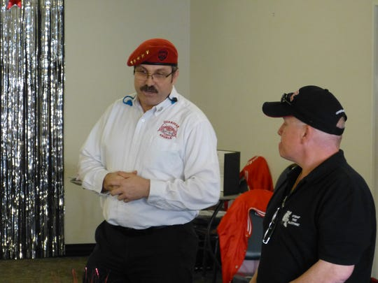 Sean Rodgers, western region director for the Guardian Angels, left, introduces Stomp the Bullying co-creator Sean Kelley at a seminar Saturday at the Redding Rancheria.