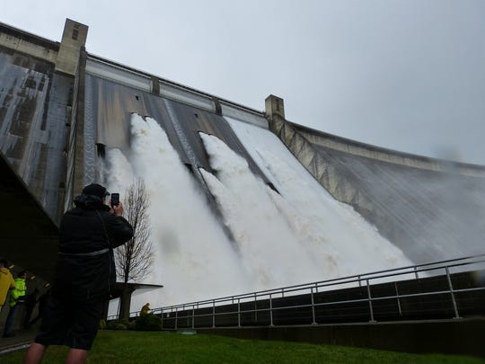 The Bureau of Reclamation invited about 30 local officials to watch water gush from Shasta Dam's drum gates Wednesday.