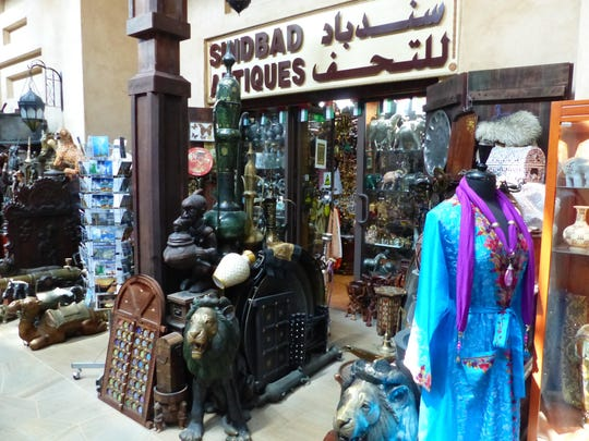 This Sept. 9, 2016 photo taken in Dubai, shows goods overflowing from a souk or small market that specializes in antiques of many kinds. Few things are sold at listed prices, though, so carry cash and sharpen your bargaining skills.