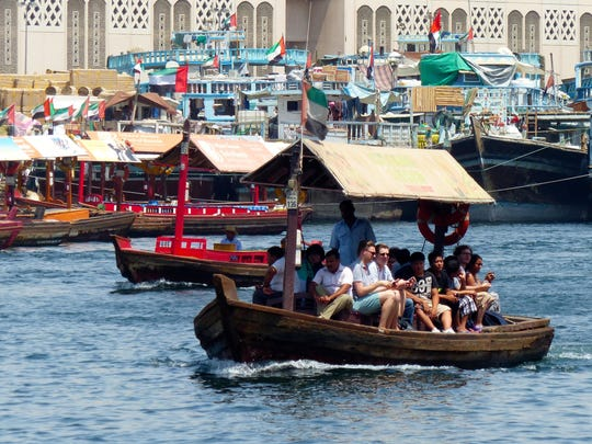 This Sept. 9, 2016 photo taken in Dubai at Dubai Creek, which is fed by waters from the Arabian Gulf, shows people packed shoulder-to-shoulder as they take in the sights of the historic Bur Dubai and Deira districts. These motorized water taxis are a breezy and old-fashioned way to reach the traditional souks, which sell everything from gold to perfumes and spices.