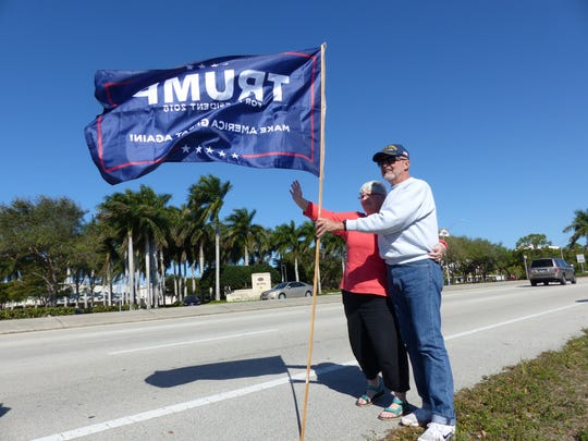 Dusty and J.B. Holmes, of Naples, hold a Trump sign at the local rally on U.S. 41 during a nationwide day of support for the Donald Trump administration on March 4, 2017.