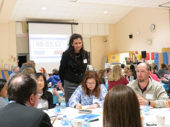Millburn Superintendent of Schools Christine Burton listens as residents discuss student stress at a Feb. 15, 2017 forum on student health and wellness.