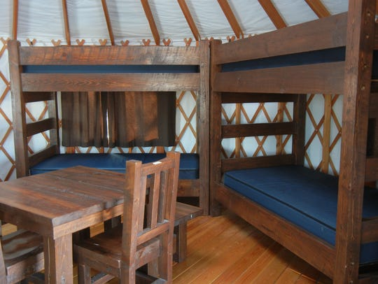 Bunks line the interior of a state park yurt.