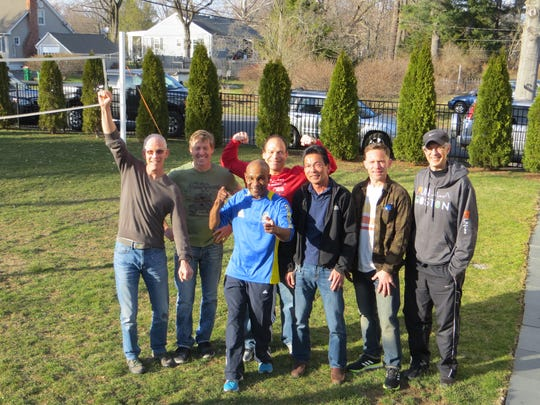 Local runners, from left, Kevin Dollard, John Mckee, Michel Joseph, Neil Grencer, Steve Miura, David Osterhoudt and Anthony Ferreri, gathered at Mckee's home in Poughkeepsie for a pre-Boston Marathon party last week.