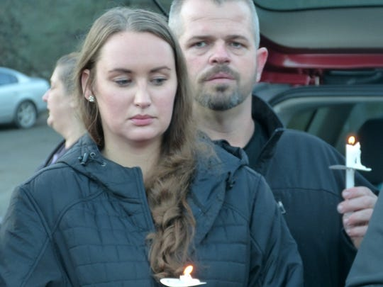 Nicole Santos-Hamann and her husband, Mike, are shown at a December balloon release and vigil for her mother, Stacey Smart.