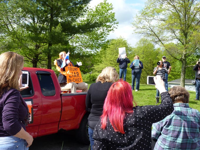 Anti-Trump protesters rallied at the Clarence Dillon