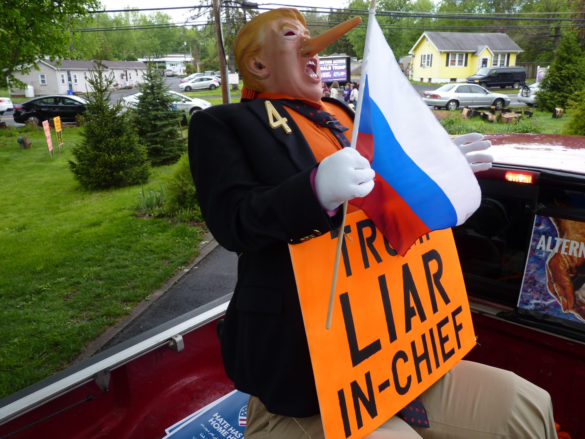 An anti-Donald Trump effigy in the back of the pickup that led the motorcade to Trump National Golf Club in Bedminster last month.