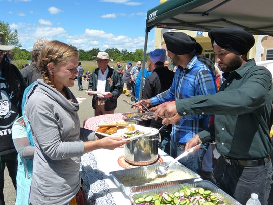 "People line up for lunch, also called a ""langar,"" for the Vaisakhi celebration on Saturday."