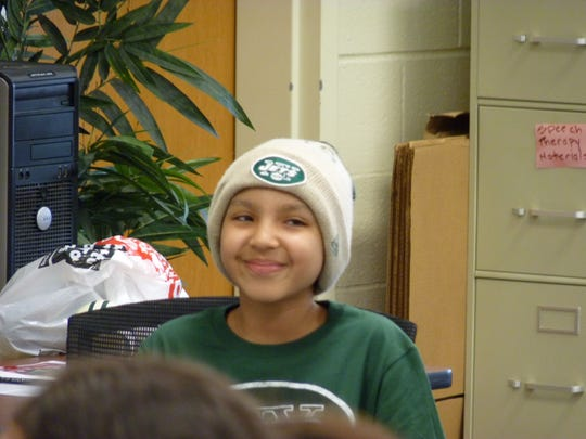 Fifth-grader Keishla Pacheco, who was diagnosed with cancer in July, wrote a letter to Jets football player Muhammad Wilkerson that prompted him to visit her at Charles H. Stillman Elementary School in Plainfield.