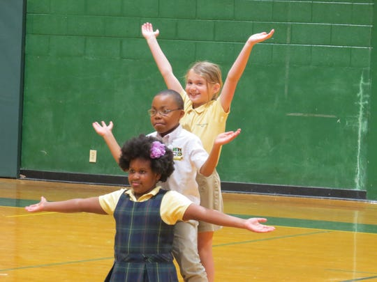 Maasai Hurt of Plainfield (front), Tawanda Sibanda of Edison and Deanna Nicholls of Dunellen, second grade students at The Wardlaw-Hartridge School in Edison, performed for their Lower School classmates as the culmination of their Dance to Learn program.  The eight-week program was taught by Danielle Mondi, a teaching artist for Lustig Dance Theater's Dance to Learn program through Young Audiences of NJ.