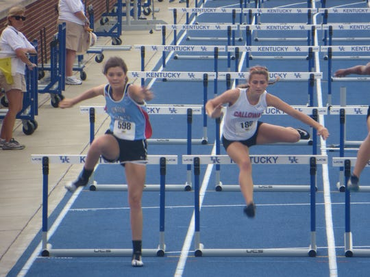 Courtlyn Beaven leaps over her last hurdle.