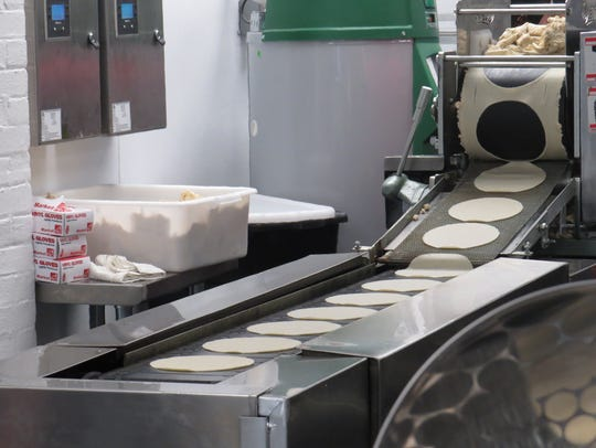 A tortilla maker is tested at Tito's Burritos in Boonton.