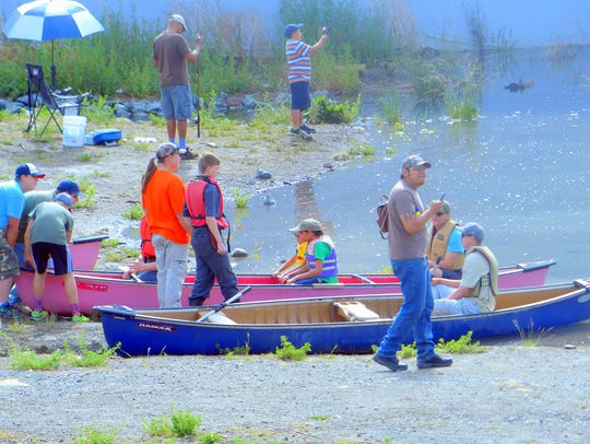 Some young anglers stayed on shore to fish while others