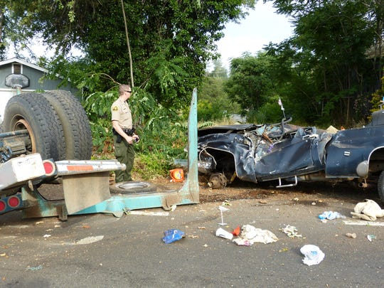 A pickup parked in a lot off Ashby Road was destroyed Wednesday when a logging truck overturned.
