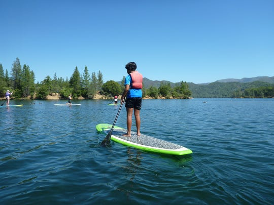 This is the second summer for Whiskeytown's stand-up paddleboarding program.