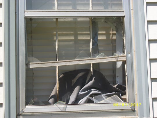 A photo of a window broken on July 1 at the home of