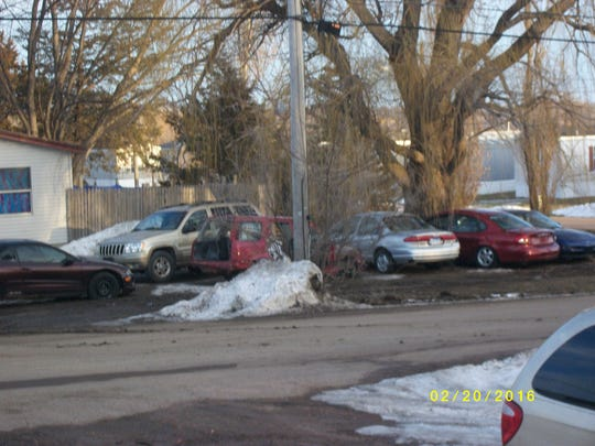 A photo showing multiple vehicles parked across the
