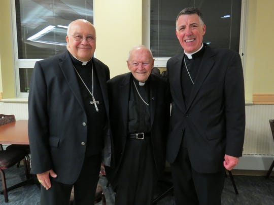 Cardinal Theodore E. McCarrick, Archbishop Emeritus of Washington and first Bishop of Metuchen, (center) poses with Bishop Emeritus Paul G. Bootkoski (left) and Bishop James F. Checchio (right).