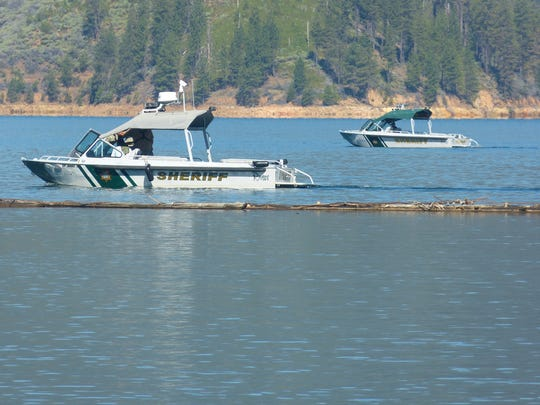 Two sheriff's boats search the waters of Lake Shasta near Digger Bay Wednesday for a 12-year-old boy presumed dead in a Monday boating accident.
