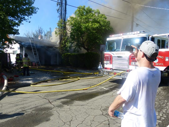 Neighbors and others filmed Tuesday's house fire on